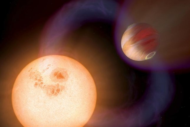 Because hot Jupiters orbit so close to their host stars, their magnetic fields interact with their sun's emissions, as pictured in this illustration. Photo by NASA/ESA/A. Schaller for STScI