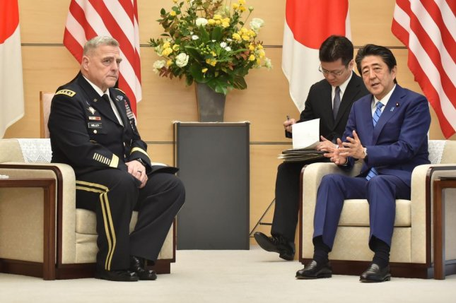 Japan's Prime Minister Shinzo Abe (R) meets with U.S. Chairman of the Joint Chiefs of Staff Gen. Mark Milley (L) at Abe's office in Tokyo on Tuesday. Pool Photo by Kazuhiro Nogi/EPA-EFE