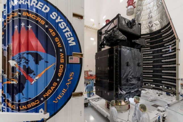 Technicians prepare a space-based infrared system satellite for launch. The Harris Corp. received a $72 million contract, the U.S. Air Force announced on Thursday, to maintain electric warfare systems. Photo courtesy of the U.S. Air Force