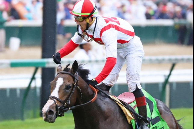 Bricks and Mortar wins Saturday's Grade I Turf Classic at Churchill Downs, part of a spectacular weekend for trainer Chad Brown. (Photo courtesy of Churchill Downs