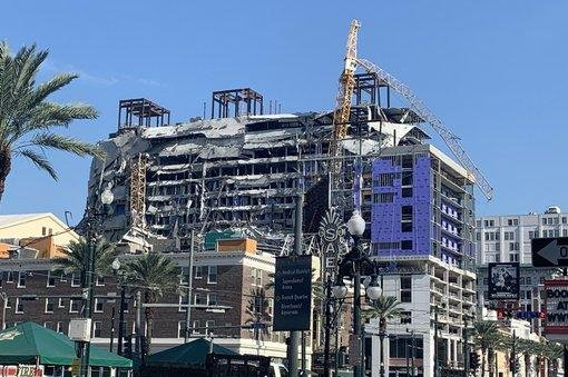 Explosions at a partially collapsed hotel in downtown New Orleans toppled two cranes Sunday to better secure the area. Photo courtesy of New Orleans Mayor LaToya Cantrell/Twitter