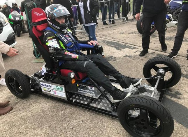 Jason Liversidge took his custom-built electric wheelchair up to a top speed of over 66 mph to break a Guinness World Record. Photo courtesy of Guinness World Records
