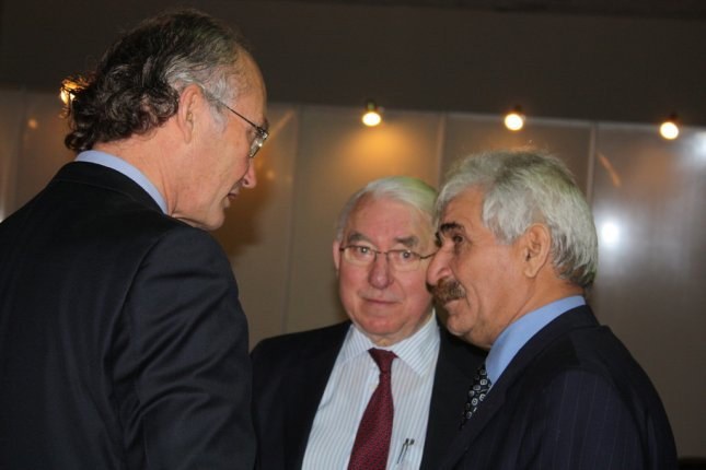 Mesopotamia Petroleum's Stephen Remp, Peter Redman (left, center) talk with Iraq Drilling Co. head Idriss Muhsen al-Yassiri prior Yassiri announcing their joint venture at the Iraq Energy Expo & Conference in Baghdad. (Ben Lando/Dec. 7, 2008)