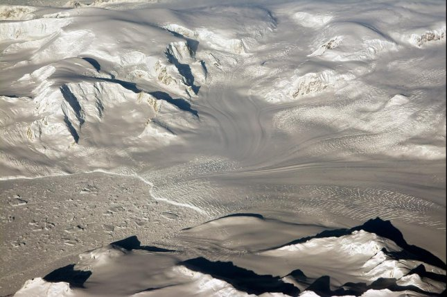 A new gravitational survey suggests large ocean floor valleys are hiding beneath the West Antarctic glaciers flowing into the Amundsen Sea. Photo by Michael Studinger/NASA
