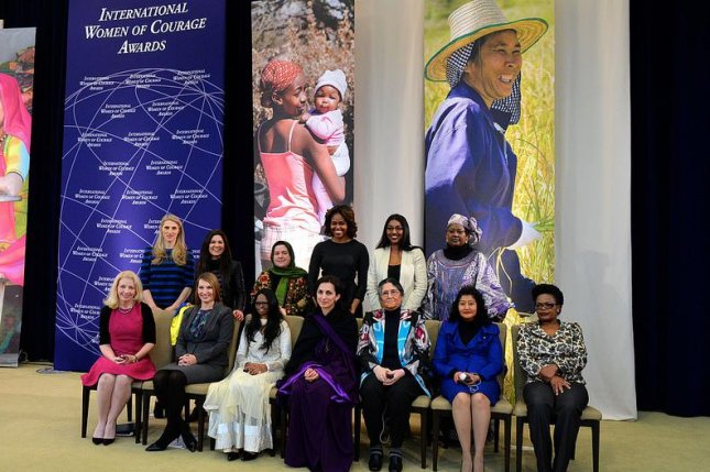 First Lady Michelle Obama, Deputy Secretary Heather Higginbottom, and U.S. Ambassador-at-Large for Global Women's Issues Catherine Russell pose for a photo with the 2014 Secretary of State's International Women of Courage Awardees at the U.S. Department of State in Washington, D.C., on March 4, 2014. (Flickr/State Department)