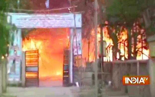 A squatters' encampment in a Mathura, India, public park burns after police expelled the political and religious sect illegally occupying it. At least 24 people, including two police officers, died in the incident, including 11 who perished in the fire. Screenshot from YouTube