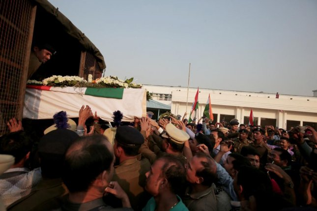 Indian Central Reserve Police Force (CRPF) personnel load a coffin of a killed soldier in a Kashmir terror attack at Kolkata Airport eastern India. Photo by Piyal Adhikary/EPA-EFE
