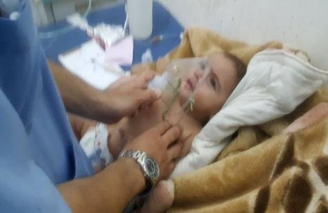 A patient is treated for suspected exposure to chlorine gas in Saraqeb, Syria. Both sides in the Syrian civil war traded accusations of use of toxic gas in attacks on civilian populations in northern Syria on Tuesday. Photo courtesy of the Syrian National Coalition.