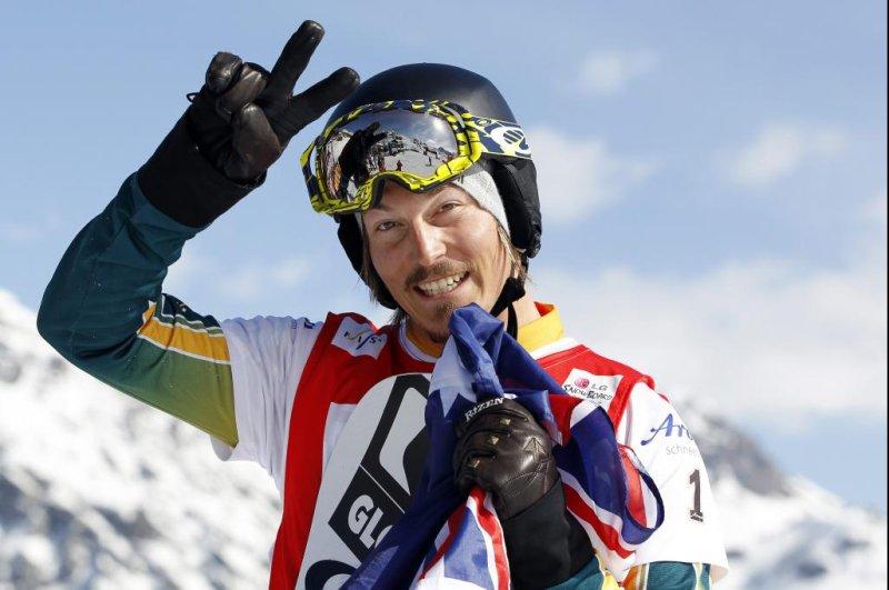 Alex Pullin of Australia celebrates after winning the Snowboard-Cross FIS World Cup Final in Arosa, Switzerland, on March 25, 2011. File Photo by Alessandro Della Bella/EPA-EFE