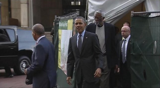 President Barack Obama, Massachusetts Gov. Deval Patrick and Celtics great Bill Russell exit the tent after viewing the statue to Russell in Boston's City Plaza. (Twitter/Peteswire)