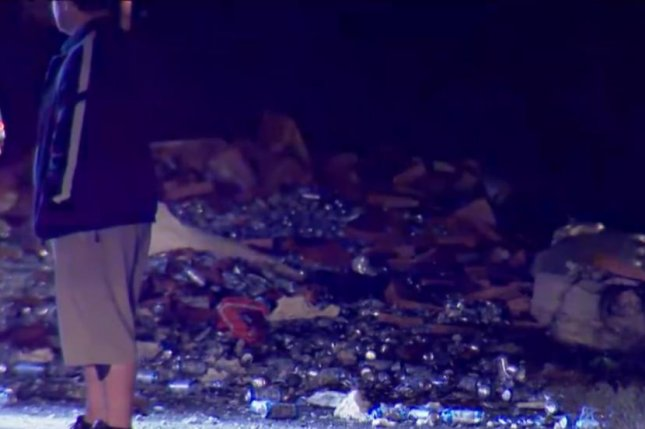 Crushed Busch beer cans and Frito Lay potato chips litter Interstate 95 in Florida after two trucks collided. Screenshot: WESH 2 News/Facebook video