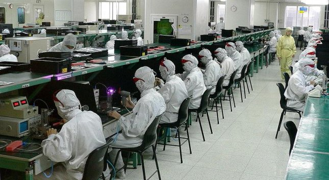 Foxconn, a supplier of electrical components to apple and Samsung, says replaced half the 110,000-person workforce in its Kunshan, China, factory with robots and artificial intelligence. Photo by Steve Jurvetson/Wikimedia