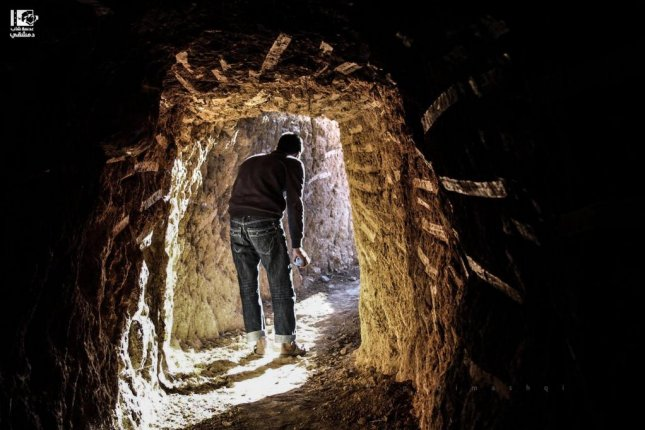 A young man walks through a tunnel used for military operations in Daraya, in the Damascus countryside on December 8. Photo by Lens of A Young Damascene Man