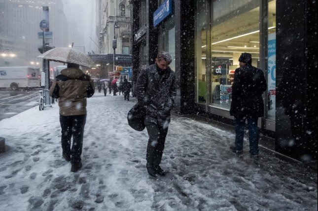 Pedestrians bundle up as they walk through the first snow of the season in New York City. Forecasters say record-setting cold may be coming for the Northeast this week. Photo courtesy of the City of New York/Twitter