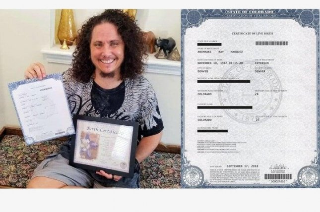 Anunnaki Marquez poses with an altered birth certificate from the state of Colorado where the gender has been changed from female to intersex. Photo courtesy of Anunnaki Marquez