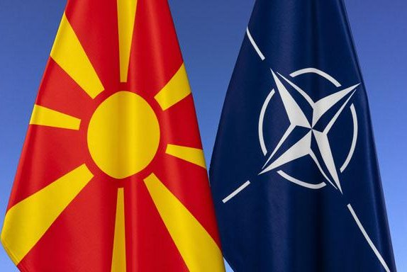 The North Macedonian flag, left, will be raised at NATO headquarters Monday following news that the country has officially joined the alliance. The NATO flag is shown at right. Photo courtesy of NATO
