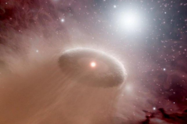 An artist's rendering shows a star's protoplanetary disc being evaporated by the radiation of its neighbor. Photo by NASA/JPL-Caltech/T. Pyle/SSC