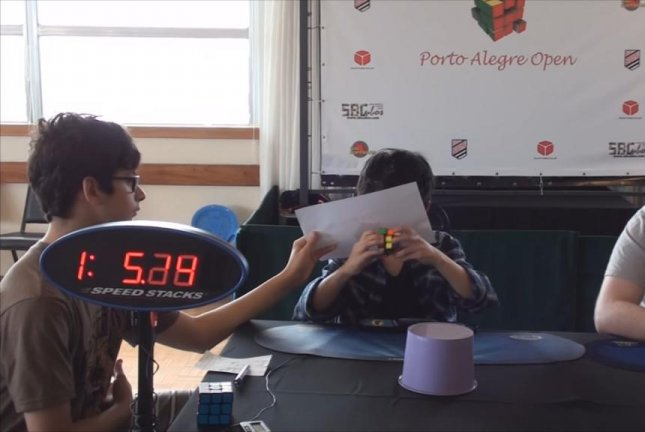 An 8-year-old boy takes on a Rubik's cube while blindfolded. Screenshot: Storyful