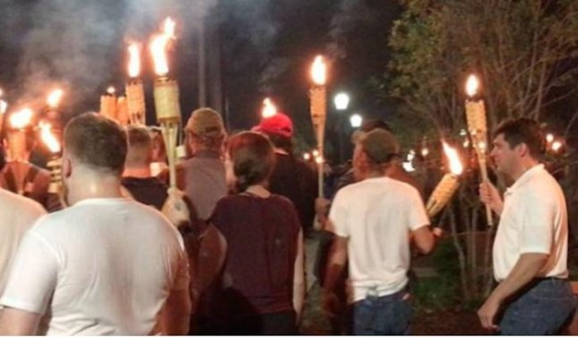 Hundreds of torch-bearing white nationalists marched on the University of Virginia's campus and clashed with counterprotesters on Friday night in advance of Saturday's Unite the Right rally. 
