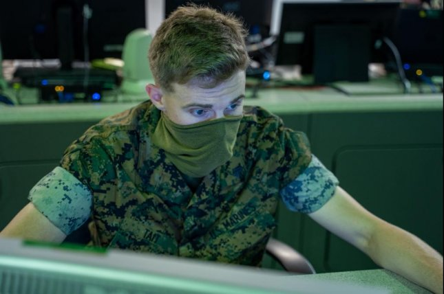 A U.S. Marine monitors network activity from the operations floor at Marine Corps Base Quantico, Va., Monday.