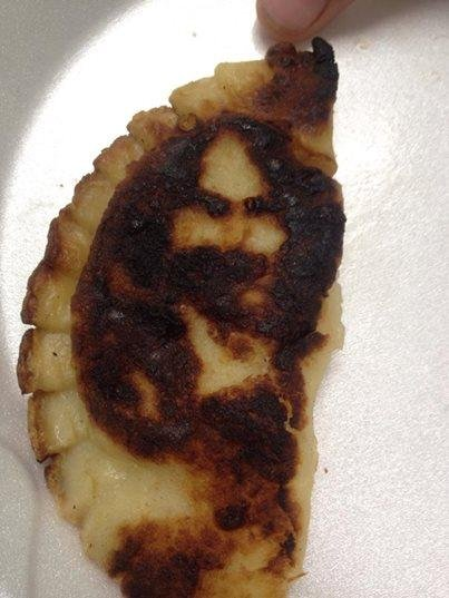 This pierogi, said by some to bear the face of Jesus, was cooked Saturday at the St. Andre Bessette Church Festival in Ecorse, Mich. (St. Andre Bessette Church)