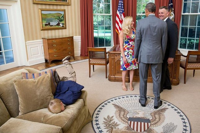 Bored Little Boy On The Oval Office Couch As U S President Barack Visits With His Pas A Departing United States Secret Service Agent And