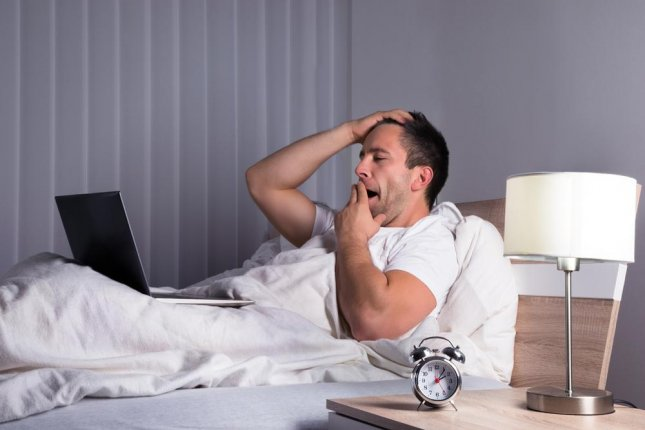 People often brag about being too busy to sleep but researchers said the risks to their health aren't worth the glory or the exhaustion. Photo by Andrey_Popov/Shutterstock