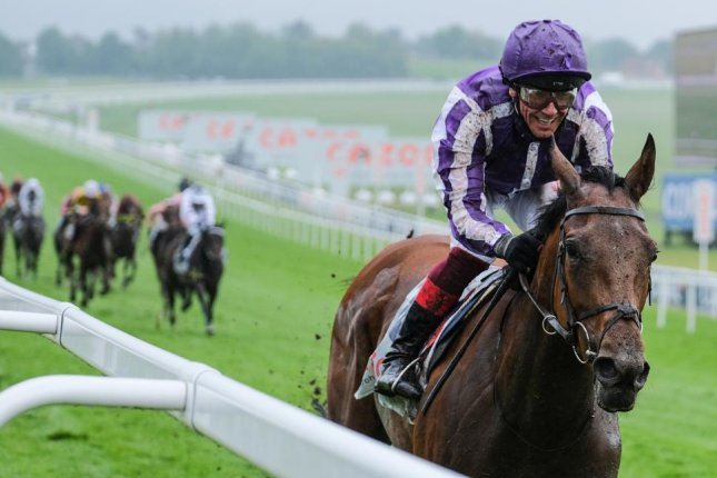 Snowfall, with Frankie Dettori smiling broadly, romps to a 16-lengths win in the Cazoo Oaks on Friday at Epsom Downs. Photo courtesy of The Jockey Club