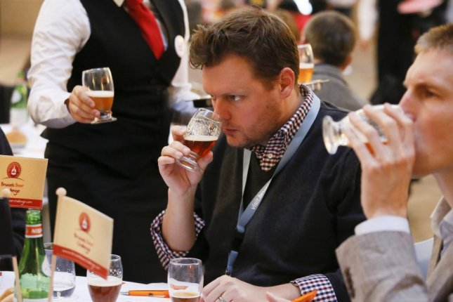 A jury member taste a beer during the 5th Brussels Beer Challenge in Brussels, Belgium, on Nov. 5. A brewery group from Belgium has applied to UNESCO to seek official cultural recognition for the nation's beer brewing and drinking traditions. Photo by Julien Warnard/European Press Agency