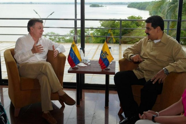 Colombian President Juan Manuel Santos (L) traveled to Venezuela to meet his Venezuelan President Nicolas Maduro on Thursday. The leaders agreed to partially reopen the shared border after nearly a year since it was closed. Photo courtesy of Juan Manuel Santos