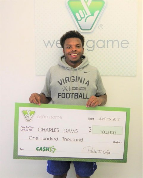 Charles Davis, a freshman player for the University of Virginia, won a $100,000 lottery jackpot by using the numbers from his grandmother's license plate. He saved most of his winnings, purchasing only a pair of Gucci flip-flops. Photo courtesy of the Virginia Lottery