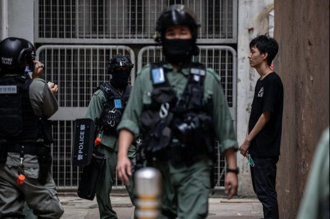 A man is detained and searched by police during a rally against the national security law in Hong Kong Wednesday. On Friday Chinese officials confirmed that party hardliner Zheng Yanxiong had been appointed to oversee implementation of the new law. Photo by Jerome Favre/EPA-EFE