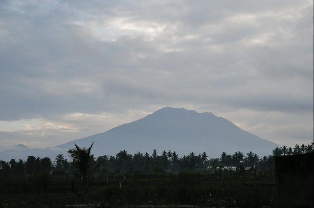 Nearly 50,000 have fled from Mount Agung's surroundings in Bali, due to a potentially imminent explosion from the volcano. Photo by Made Nagi/EPA
