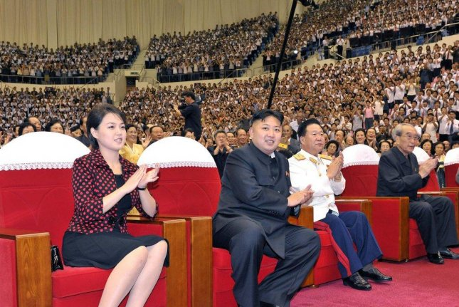 Ri Sol Ju, the wife of North Korean leader Kim Jong Un, is a popular fashion role model, according to a recent report. File Photo by Yonhap
