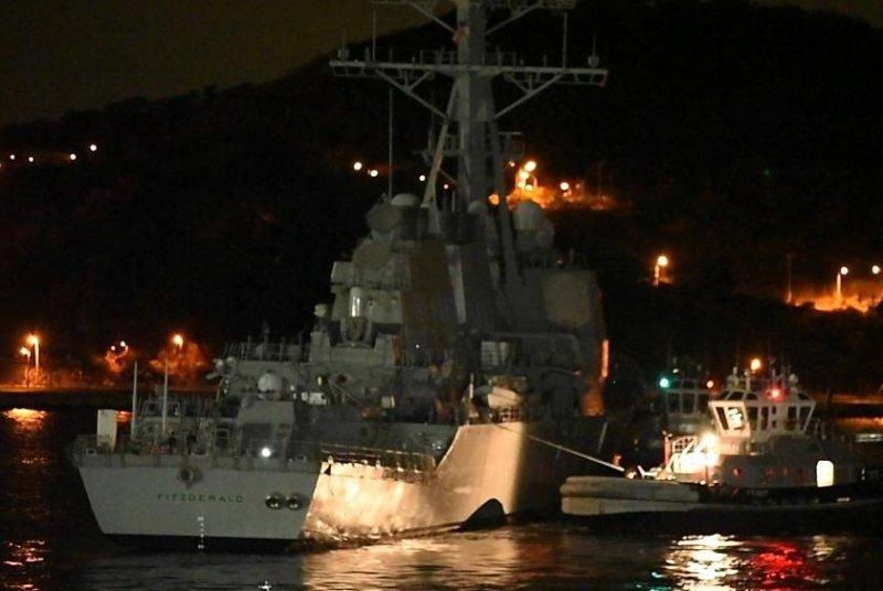 The Arleigh Burke-class guided-missile destroyer USS Fitzgerald is towed away from the pier at Fleet Activities Yokosuka on Nov. 24, 2017, to meet heavy lift transport vessel MV Transshelf. Photo by Mass Communication Specialist 1st Class Benjamin Dobbs/U.S. Navy