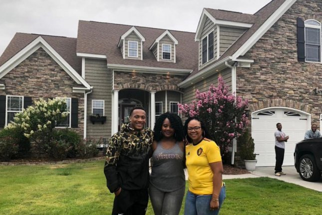 Mike Hughes (L), who was the 30th overall pick in the 2018 NFL Draft, revealed on Twitter Saturday that he bought a house for his mother. Photo courtesy of Minnesota Vikings/Twitter