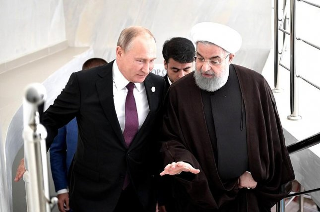 Russian President Vladimir Putin (L) meets with Iranian President Hassan Rouhani on the sidelines of a Caspian Sea summit. Littoral states made little headway in resolving energy disputes. Photo courtesy of the office of the Russian president