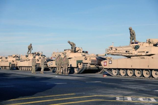 U.S. Army tanks of the 1st Armored Brigade Combat Team, 1st Infantry Division, travel through Antwerp, Belgium. The Army announced its next equipment and personnel rotation under the Atlantic Resolve program on Wednesday. Photo by Sgt. Benjamin Northcutt/U.S. Army/UPI