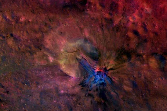 This colorful composite image from NASA's Dawn mission shows the flow of material inside and outside a crater called Aelia on the giant asteroid Vesta. (Credit: NASA/JPL-Caltech/UCLAMPS/DLR/IDA)