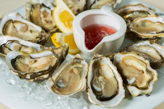 Despite it being well known that eating raw oysters is a risk, many people choose to enjoy them uncooked and on ice anyway. Photo by SARYMSAKOV ANDREY/Shutterstock