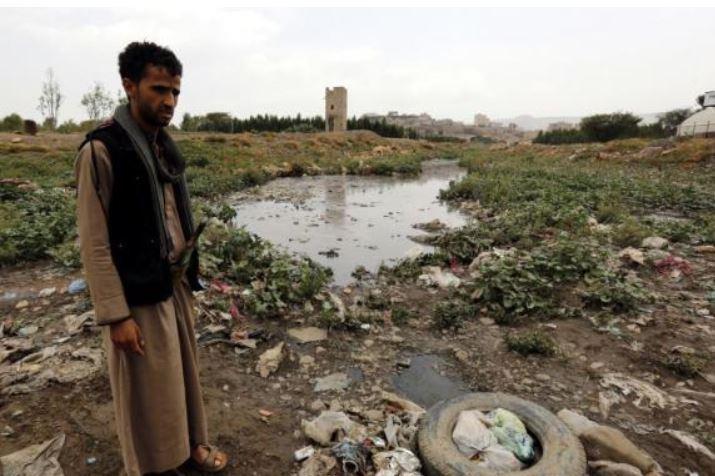 A Yemeni stands near a sewage swamp, a breeding ground for cholera, in Sana'a, Yemen. The World Health Organization urged Saudi Arabia on Thursday to end the blockade of Yemeni seaports and airports so humanitarian supplies can arrive. File photo Yahya Arhab/EPA