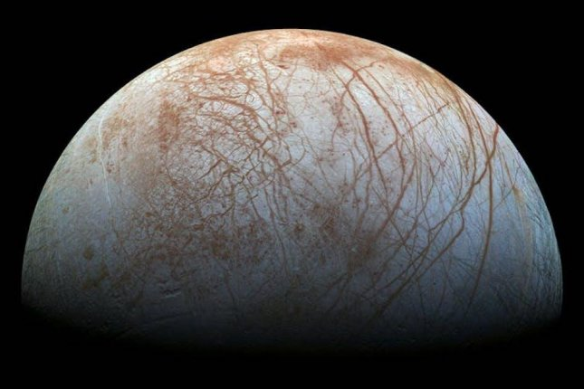 Scientists believe Jupiter's moon Europa is home to a subsurface ocean and that water plumes are ejected through tissues in the moon's icy surface. Photo by NASA/JPL-Caltech