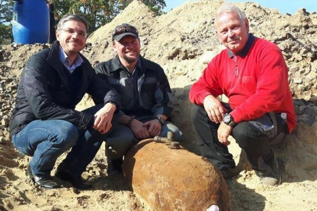 Bomb disposal personnel pose with an unexplored, World War II-era bomb safely defused and removed Wednesday in Potsdam, Germany. The 550-pound, U.S.-made bomb was discovered during excavation for an apartment building. Photo courtesy of City of Potsdam