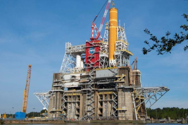 NASA's Space Launch System rocket's core stage is loaded onto a test stand at Stennis Space Center in south Mississippi, where it is scheduled for a full, eight-minute test fire this fall. File Photo courtesy of NASA