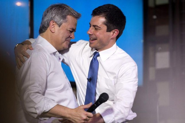 Austin, Texas Mayor Steve Adler welcomes presidential candidate Pete Buttigieg to the stage during a campaign stop at Buford's Beer Garden in Austin on August 10. Photo by  Mikala Compton for The Texas Tribune