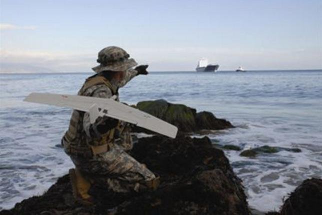 The U.S. Air Force awarded a $975 million contract in support of efforts to combat illegal drug trafficking and piracy. Picture, and AeroVironment Wasp III intelligence and surveillance unmanned aerial system launched from the coast. Photo courtesy Aerovironment