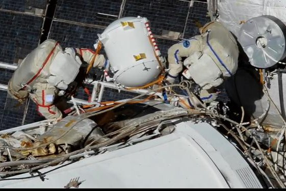 Russian cosmonauts try to replace an old fluid flow regulator unit from outside their nation's portion of the International Space Station during a spacewalk Wednesday, but were unable to open the container because of a balky bolt. Photo courtesy of NASA