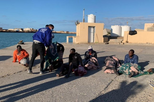 International Organiztion of Migration staff assisting survivors of Tuesday's shipwreck off Zwara. Photo courtesy of International Organization of Migration Libya 2021