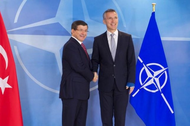 Turkish Prime Minister Ahmet Davutoglu, left, received the support of NATO Secretary-General Jens Stoltenberg in Brussels on Monday, after Davutoglu's announcement that Turkey would not apologize to Russia for the downing of a Russian fighter plane. Photo courtesy of NATO