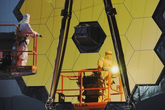Engineers at NASA's Goddard Space Flight Center conduct a center of curvature test on the James Webb Space Telescope's massive mirror array. Photo by NASA/Chris Gunn